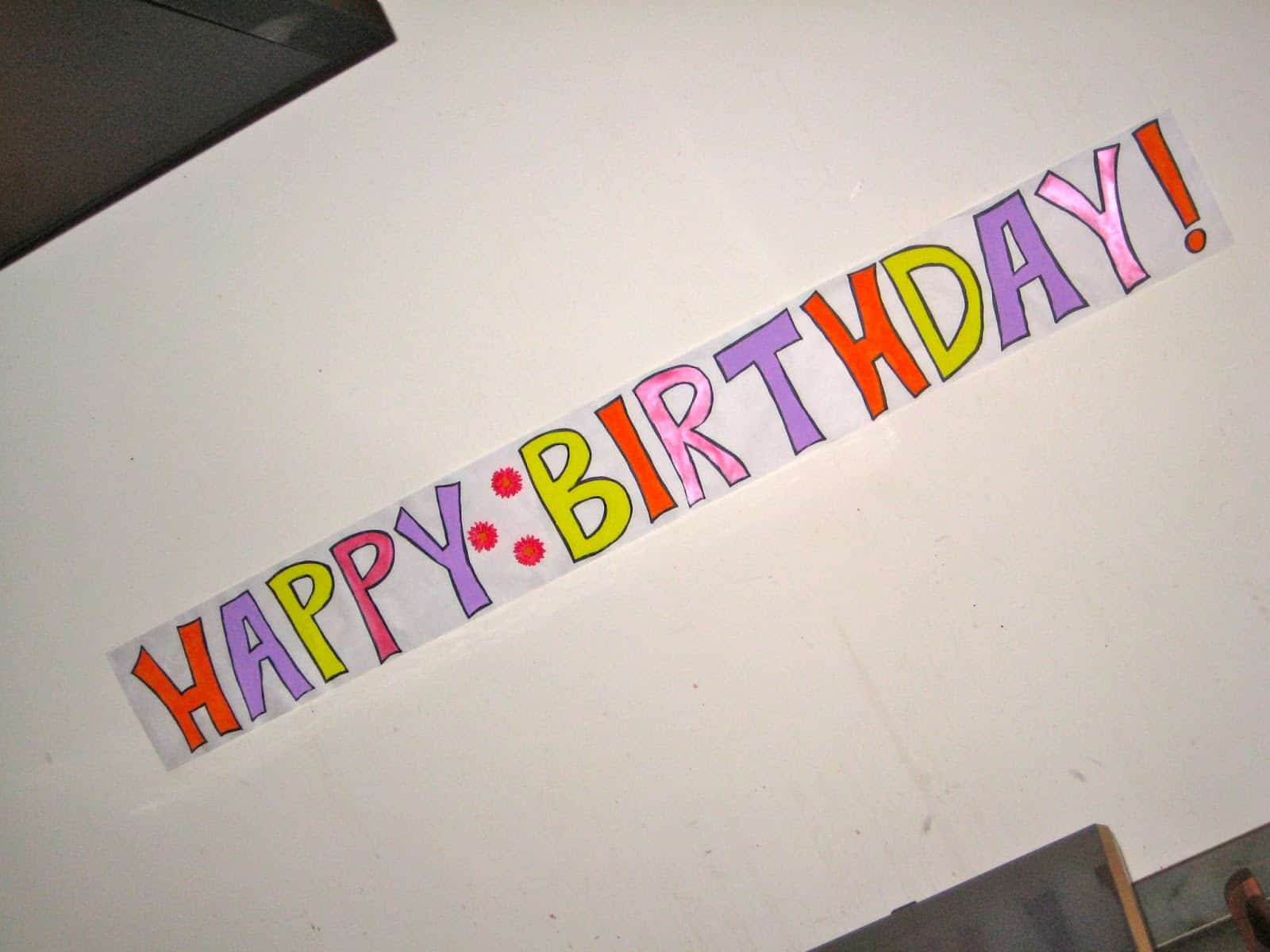 a colourful happy birthday sign