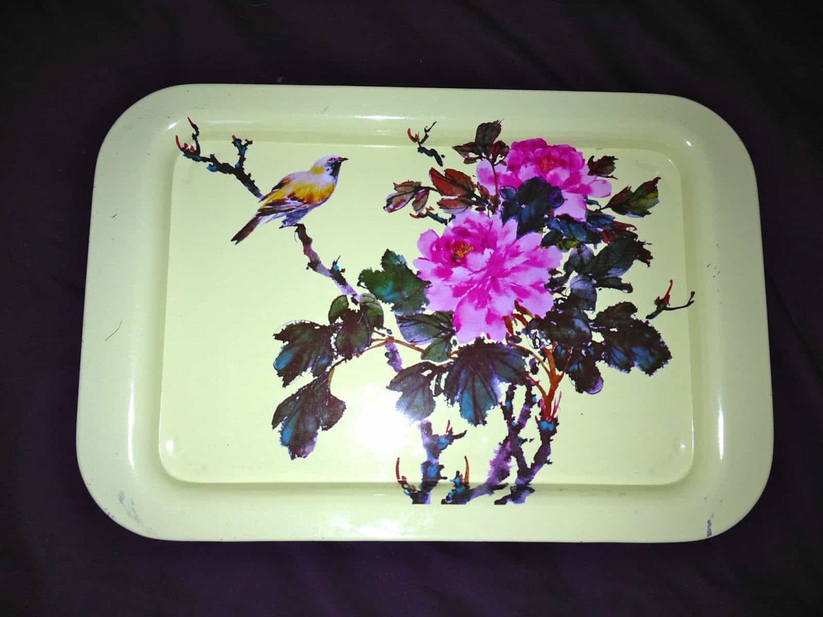 a retro metal tray with birds and flowers