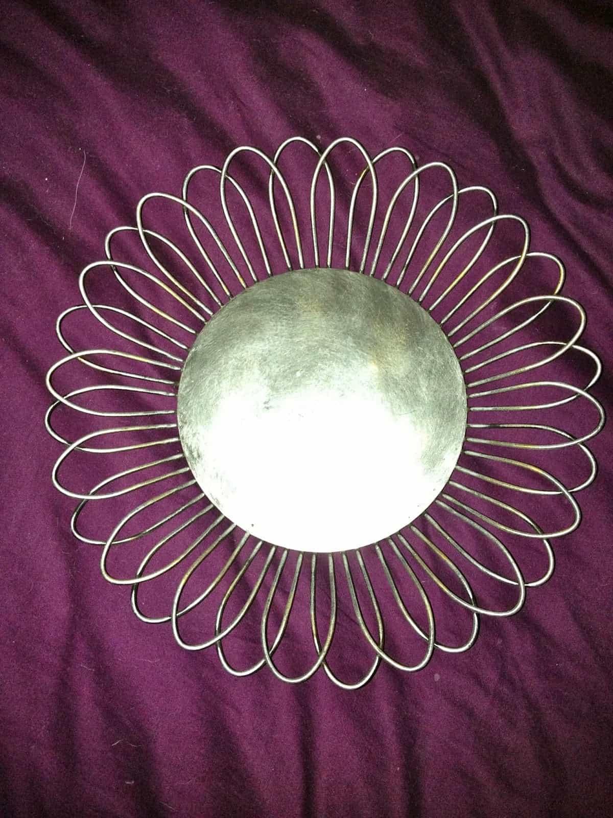 silver metal flower on a purple background