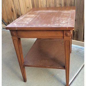 a vintage side table before being painted