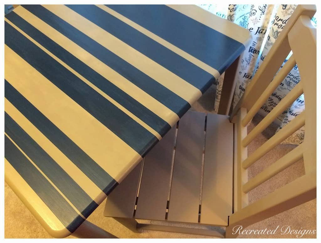 painting stripes on a table