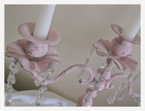 candle holders painted and distressed with pink paint