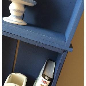 blue shelves of a bookshelf