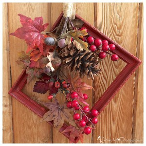 a fall wreath inside of a vintage frame painted red