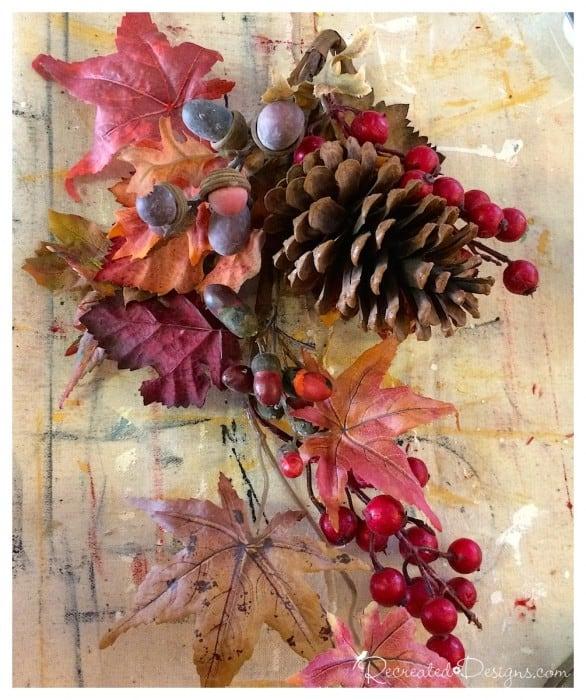 fall foliage and a pinecone