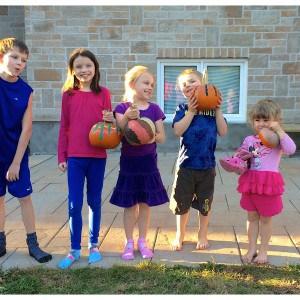 children holding their painted pumpkins