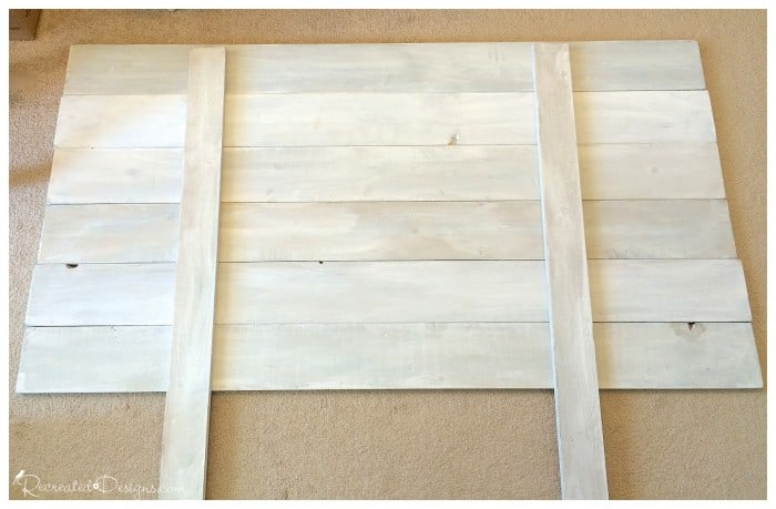 laying out the pieces for a DIY headboard
