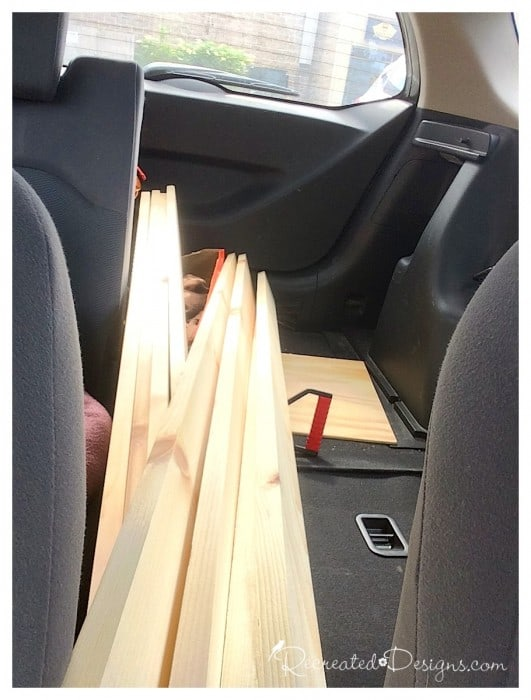 pine boards being brought home to make a new headboard