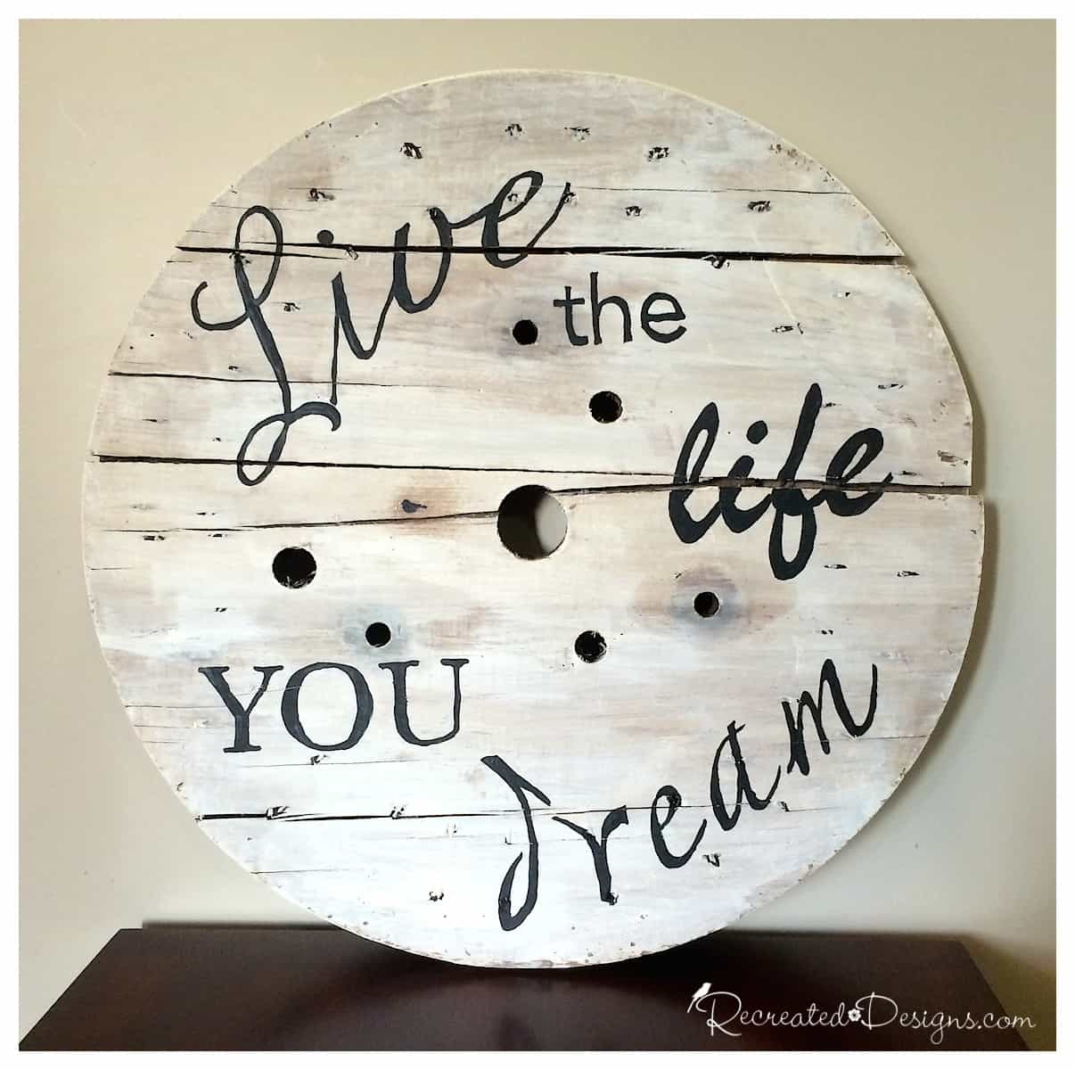 old wooden spool turned into wall art