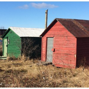 red and green boat houses in winter