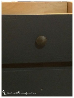 reclaimed knobs on old wood drawers