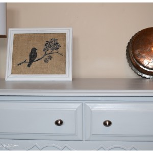 items on top of a grey dresser