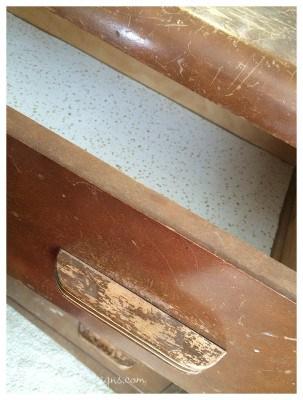 the inside of a vintage dresser drawer