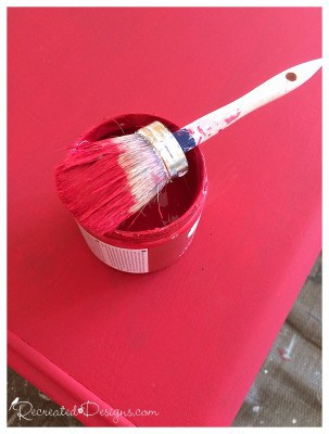 Decoart Chalky Finish Paint in Romance with a round paint brush