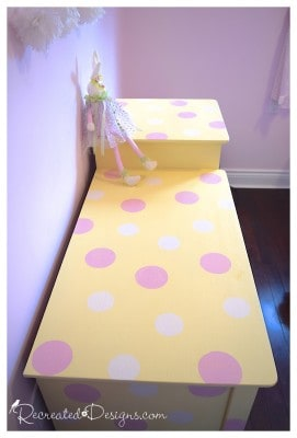 white and pink polka dots on a yellow painted change table
