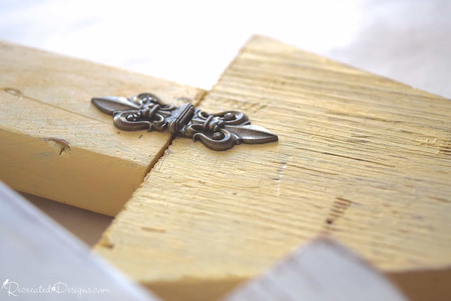 vintage hardware on a yellow painted wood arrow