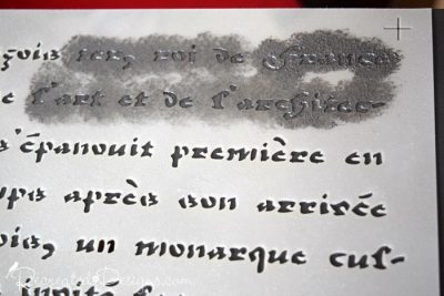 using a stencil to add French Script to a black dresser