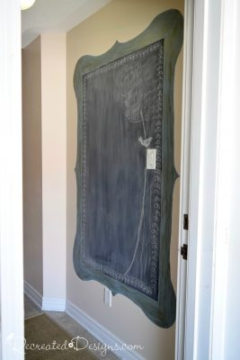 entryway chalkboard with a blue frame painted directly onto the wall
