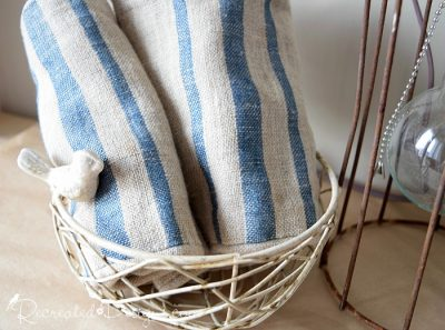 birds nest with vintage linens
