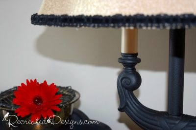 black mat paint with glaze over top and a red flower
