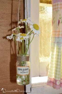 vintage spice bottles turned into vases for wildflowers