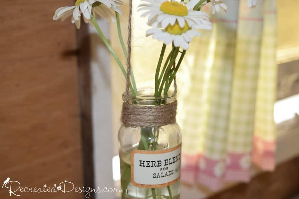 vintage spice bottle hanging with a daisy