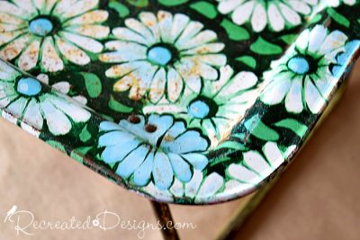 retro metal tray covered with daisies and rust