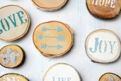 blue and white painted wood slices turned into magnets