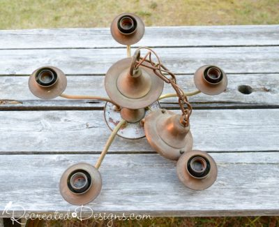 the top of an old, rusty chandelier found at a dump