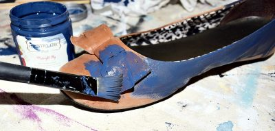 leather shoes being painted with Country Chic Paint in Midnight Sky