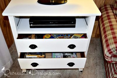 the drawers of a vintage dresser used for DVDs and games
