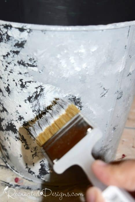 stippling on different colours of paint to get a faux galvanized metal look on a pail