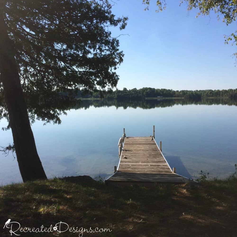 A wooden dock on a lake at a cottage