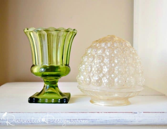 """A glass vase and light globe found at the dump """"store"""" before painting"""