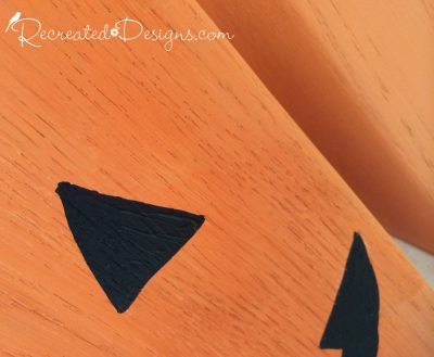 Annie Sloan Barcelona Orange Chalk Paint used to turn wood canisters into Jack-O-Lanterns