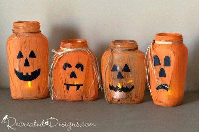 glass jars turned into Jack-O-Lanterns