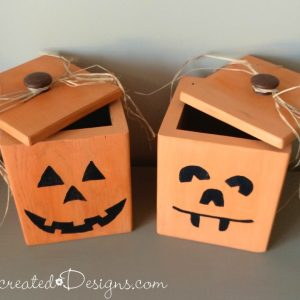 wood canisters turned into jack-o-lanterns to hold candy