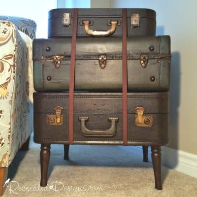 Three vintage suitcases stacked to make a table and coloured with General Finishes Java Gel Stain