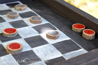 checkers made out of small woodslices