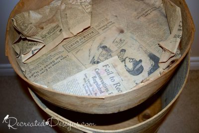 an old newspaper found inside of an old cheese barrel