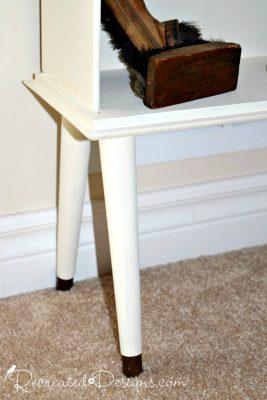 salvaged legs on drawers turned bookshelf