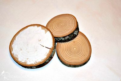 wood slices with one being painted with Casement from Fusion Mineral Paint
