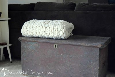 antique wood box with a large, cozy blanket