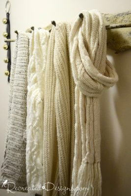 scarves hanging from rustic hooks ready for winter