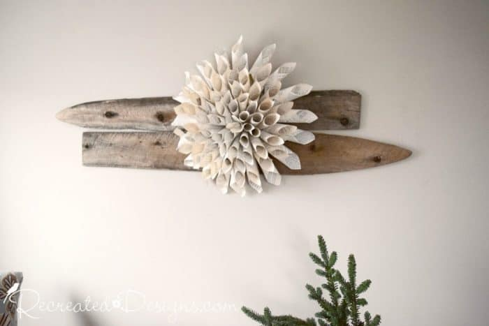 large paper flower on reclaimed wood