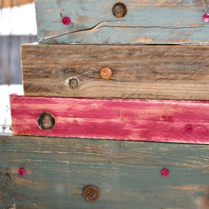 adding vintage buttons to reclaimed painted wood