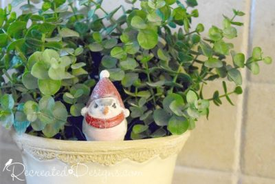 little bird ready for winter sitting in a plant