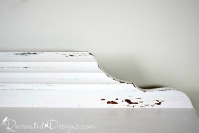 chippping and distressing on a dresser painted with Miss Mustard Seed Milk paint in Marzipan