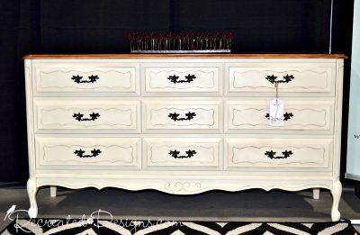 a beautiful dresser painted cream