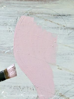 painting a pink heart on reclaimed wood with Coutry Chic Paint in Vintage Cupcake